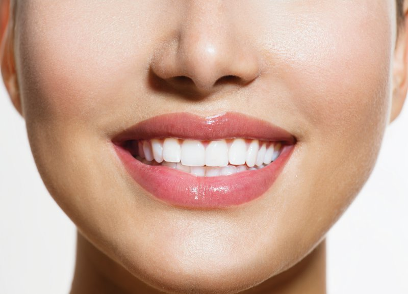 Smiling woman who just received cosmetic dentistry.