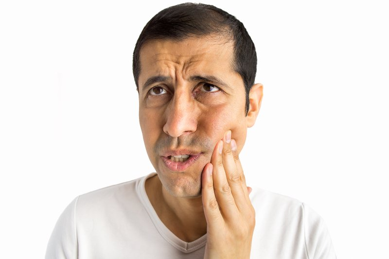 Man considering Invisalign in Beachwood for TMJ pain